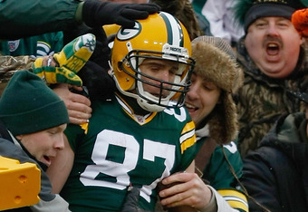 GREEN BAY, WI - JANUARY 1: Jordy Nelson #87 of the Green Bay Packers celebrates a touchdown as he jumps in the stands during the game against the Detroit Lions at Lambeau Field on January 1, 2012 in Green Bay, Wisconsin. (Photo by Scott Boehm/Getty Images