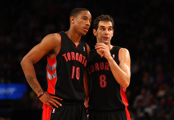 NEW YORK, NY - MARCH 20:  (L-R) DeMar DeRozan #10 and Jose Calderon #8 of the Toronto Raptors talk on court in the second half agianst the New York Knicks at Madison Square Garden on March 20, 2012 in New York City.  NOTE TO USER: User expressly acknowled