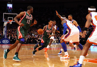 NEW YORK, NY - MARCH 26:  Monta Ellis #11 of the Milwaukee Bucks drives against Carmelo Anthony #7 of the New York Knicks at Madison Square Garden on March 26, 2012 in New York City. NOTE TO USER: User expressly acknowledges and agrees that, by downloadin