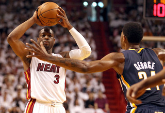 MIAMI, FL - MAY 13:  Guard Dwyane Wade #3 of the Miami Heat looks to pass against Guard Paul George #24  of the Indiana Pacers in Game One of the Eastern Conference Semifinals in the 2012 NBA Playoffs on May 13, 2012 at the American Airines Arena in Miami