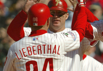 PHILADELPHIA - APRIL 15:  Mike Lieberthal #24 of the Philadelphia Phillies is congratulated by teammates Pat Burell #5 and Jim Thome #25 who scored on his three-run game winning home run off of Ryan Wagner of the Cincinnati Reds in the eighth inning as th
