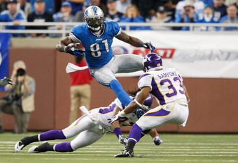 DETROIT, MI - DECEMBER 11: Calvin Johnson #81 of the Detroit Lions makes the catch a avoids the tackle of Mistral Raymond #41 and Jamarca Sanford #33 of the Minnesota Vikings during the game at Ford Field on December 11, 2011 in Detroit, Michigan. The Lio