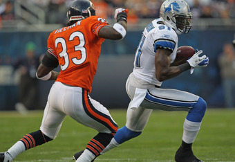 CHICAGO, IL - NOVEMBER 13: Calvin Johnson #81 of the Detroit Lions tries to move away from Charles Tillman #33 of the Chicago Bears at Soldier Field on November 13, 2011 in Chicago, Illinois. The Bears defeated the Lions 37-13. (Photo by Jonathan Daniel/G