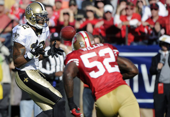 SAN FRANCISCO, CA - JANUARY 14:  Marques Colston #12 of the New Orleans Saints catches a pass over Patrick Willis #52 of the San Francisco 49ers  during the Divisional Playoffs at Candlestick Park on January 14, 2012 in San Francisco, California. The 49er