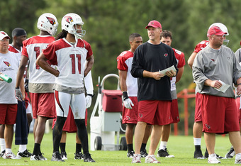 FLAGSTAFF, AZ - JULY 30:  Head coach Ken Whisenhunt (R) of the Arizona Cardinals talks with wide receiver Larry Fitzgerald #11 during the team training camp at Northern Arizona University on July 30, 2011 in Flagstaff, Arizona.  (Photo by Christian Peters