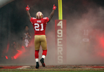 SAN FRANCISCO, CA - JANUARY 22:  Running back Frank Gore #21 of the San Francisco 49ers runs onto the field during player introductions against the New York Giants during the NFC Championship Game at Candlestick Park on January 22, 2012 in San Francisco,