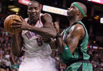 BOSTON, MA - JANUARY 16:  Kendrick Perkins #5 of the Oklahoma City Thunder heads to the net as Jermaine O'Neal #7 of the Boston Celtics defends on January 16, 2012 at TD Garden in Boston, Massachusetts. The Oklahoma City Thunder defeated the Boston Celtic