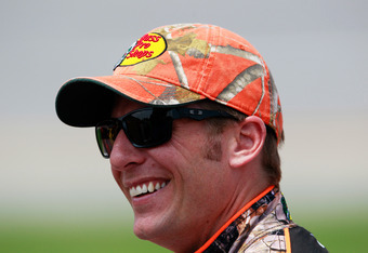 TALLADEGA, AL - MAY 05:  Jamie McMurray, driver of the #1 Bass Pro Shops/Tracker Boats Chevrolet, stands on the grid during qualifying for the NASCAR Sprint Cup Series Aaron's 499 at Talladega Superspeedway on May 5, 2012 in Talladega, Alabama.  (Photo by