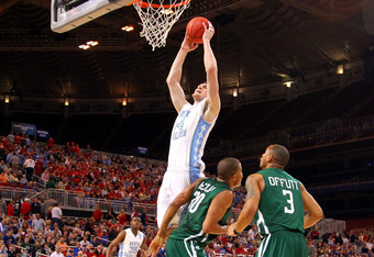 ST. LOUIS, MO - MARCH 23:  :  :  :  Tyler Zeller #44 of the North Carolina Tar Heels dunks in the first half against Reggie Keely #30 and Walter Offutt #3 of the Ohio Bobcats during the 2012 NCAA Men's Basketball Midwest Regional Semifinal at Edward Jones