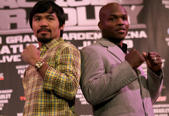 BEVERLY HILLS, CA - FEBRUARY 21:  Manny Pacquiao (L) and Timothy Bradley pose fpr photographers at a press conference announcing their upcoming World Boxing Organization welterweight championship fight at The Beverly Hills Hotel on February 21, 2012 in Be