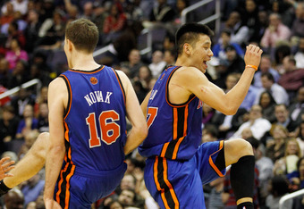 WASHINGTON, DC - FEBRUARY 08:  Jeremy Lin #17 of the New York Knicks and Steve Novak #16 celebrate during a timeout against the Washington Wizards during the second half at Verizon Center on February 8, 2012 in Washington, DC. NOTE TO USER: User expressly