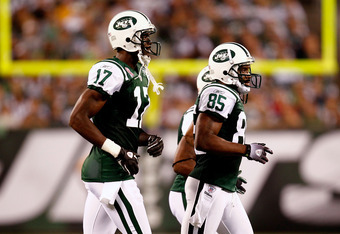 Neither Plaxico Burress (left) nor Derrick Mason (right) will suit up for the Jets in 2012.
