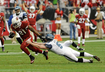 GLENDALE, AZ - JANUARY 01:  Jon Ryan #9 of the Seattle Seahawks makes a touchdown saving tackle on Patrick Peterson #21 of the Arizona Cardinals at University of Phoenix Stadium on January 1, 2012 in Glendale, Arizona.  (Photo by Norm Hall/Getty Images)