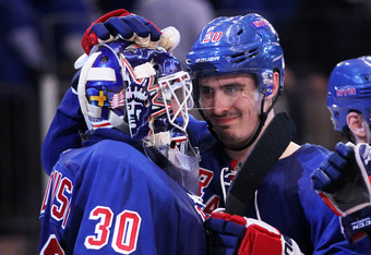 Kreider celebrates after Game 1 with goaltender Henrik Lundqvist.