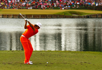 PONTE VEDRA BEACH, FL - MAY 13:  Rickie Fowler of the United States hits his tee shot on the 17th hole during the final round of THE PLAYERS Championship held at THE PLAYERS Stadium course at TPC Sawgrass on May 13, 2012 in Ponte Vedra Beach, Florida.  (P