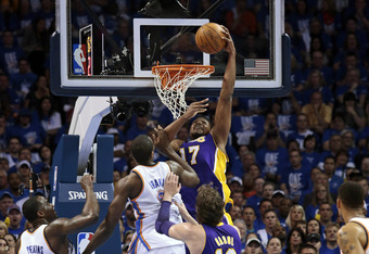 OKLAHOMA CITY, OK - MAY 14:  Andrew Bynum #17 of the Los Angeles Lakers slam dunks in front of Serge Ibaka #9 of the Oklahoma City Thunder in Game One of the Western Conference Semifinals in the 2012 NBA Playoffs on May 14, 2012 at the Chesapeake Energy A