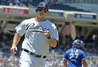 SAN DIEGO, CA - JUNE 29: Anthony Rizzo #27 of the San Diego Padres celebrates as he scores during the third inning of a baseball game against the Kansas City Royals at Petco Park on June 29, 2011 in San Diego, California. The Padres won 4-1.  (Photo by De