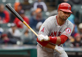 CLEVELAND, OH - APRIL 28: Albert Pujols #5 of the Los Angeles Angels of Anaheim reacts after hitting a ground ball for an out during the third inning against the Cleveland Indians at Progressive Field on April 28, 2012 in Cleveland, Ohio. (Photo by Jason