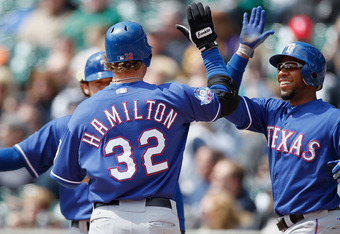 DETROIT, MI - APRIL 21: Josh Hamilton #32 of the Texas Rangers is greeted at home plate after his first inning home run by Elvis Andrus #1 and Ian Kinsler #5 while playing the Detroit Tigers at Comerica Park on April 21, 2012 in Detroit, Michigan.  (Photo