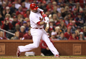ST LOUIS, MO - OCTOBER 27:  Albert Pujols #5 of the St. Louis Cardinals hits a double in the ninth inning during Game Six of the MLB World Series against the Texas Rangers at Busch Stadium on October 27, 2011 in St Louis, Missouri.  (Photo by Jamie Squire