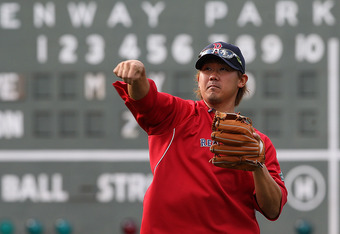 BOSTON, MA - MAY 10:  Daisuke Matsuzaka #18 of the Boston Red Sox, who has been injured, throws in the outfield before a game with the Cleveland Indians at Fenway Park May 10, 2012  in Boston, Massachusetts. (Photo by Jim Rogash/Getty Images)