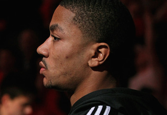 CHICAGO, IL - MAY 01:  Derrick Rose #1 of the Chicago Bulls, injured in game one against the Philadelphia 76ers, stands in front of the Bulls bench during player introductions before Game Two of the Eastern Conference Quarterfinals during the 2012 NBA Pla