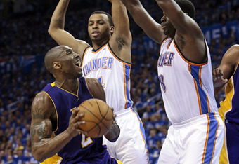 OKLAHOMA CITY, OK - MAY 14:  Kobe Bryant #24 of the Los Angeles Lakers is double teamed by Daequan Cook #14 and Nazr Mohammed #8 of the Oklahoma City Thunder in Game One of the Western Conference Semifinals in the 2012 NBA Playoffs on May 14, 2012 at the