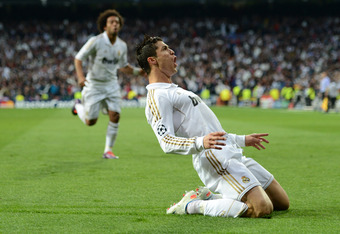 MADRID, SPAIN - APRIL 25:  Cristiano Ronaldo of Real Madrid celebrates scoring their second goal during the UEFA Champions League Semi Final second leg between Real Madrid CF and Bayern Munich at The Bernabeu Stadium on April 25, 2012 in Madrid, Spain.  (