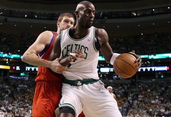 BOSTON, MA - MAY 12: Kevin Garnett #5 of the Boston Celtics tries to get around Spencer Hawes #00 of the Philadelphia 76ers  in Game One of the Eastern Conference Semifinals in the 2012 NBA Playoffs on May 12, 2012 at TD Garden in Boston, Massachusetts. N