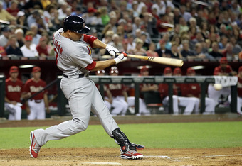 PHOENIX, AZ - MAY 09:  Carlos Beltran #3 of the St Louis Cardinals hits a RBI single against the Arizona Diamondbacks during the fifth inning of the MLB game at Chase Field on May 9, 2012 in Phoenix, Arizona.  (Photo by Christian Petersen/Getty Images)