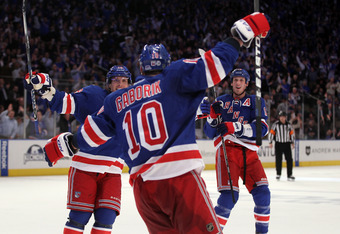 NEW YORK, NY - APRIL 12:  (L-R) Brad Richards #19, Marian Gaborik #10 and Marc Staal #18 of the New York Rangers celebrate after Gaborik scored a goal in the second period against the Ottawa Senators in Game One of the Eastern Conference Quarterfinals dur
