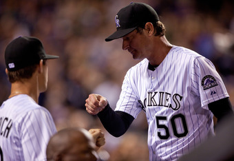 Jamie Moyer shows his whippersnapper teammates how this baseball thing is done.