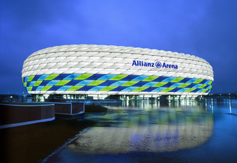 MUNICH, GERMANY - UNDATED: (EDITORIAL USE ONLY - NO COMMERCIALS) In  this handout image from the Allianz Group, the Allianz Arena is illuminated with white, green and blue lights ahead of the UEFA Champions League Final between FC Bayern Munich and Chelse