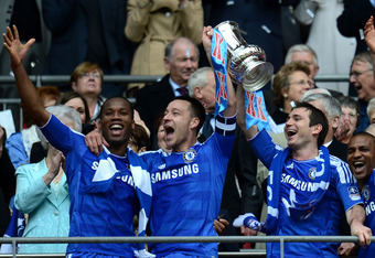 LONDON, ENGLAND - MAY 05:  (L-R) Didier Drogba, John Terry, Frank Lampard of Chelsea lift the FA Cup trophy during the FA Cup with Budweiser Final match between Liverpool and Chelsea at Wembley Stadium on May 5, 2012 in London, England.  (Photo by Shaun B