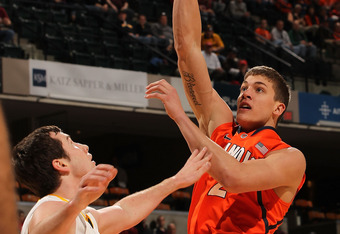 INDIANAPOLIS, IN - MARCH 08:  Meyers Leonard #12 of the Illinois Fighting Illini shoots over Zach McCabe #15 of the Iowa Hawkeyes during the first round of the Big Ten Basketball Tournament at Bankers Life Fieldhouse on March 8, 2012 in Indianapolis, Indi