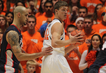 CHAMPAIGN, IL - DECEMBER 03:  Meyers Leonard #12 of the Illinois Fighting Illini looks to pass against Robert Sacre #00 of the Gonzaga Bulldogs at Assembly Hall on December 3, 2011 in Champaign, Illinois. Illinois defeated Gonzaga 82-75.  (Photo by Jonath