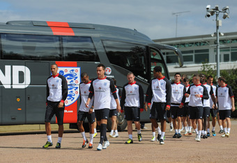 ST ALBANS, ENGLAND - AUGUST 09: John Terry, Ashley Cole and Rio Ferdinand lead out the squad during the England training session at London Colney on August 9, 2011 in St Albans, England.  (Photo by Michael Regan/Getty Images)