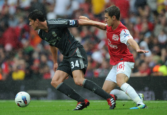 LONDON, ENGLAND - AUGUST 20:  Martin Kelly of Liverpool holds off the challenge by Aaron Ramsey of Arsenal during the Barclays Premier League match between Arsenal and Liverpool at the Emirates Stadium on August 20, 2011 in London, England.  (Photo by Mic