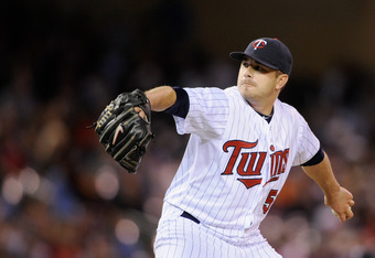 MINNEAPOLIS, MN - MAY 9:  Brian Duensing #52 of the Minnesota Twins delivers a pitch against the Los Angeles Angels of Anaheim during the seventh inning on May 9, 2012 at Target Field in Minneapolis, Minnesota. The Angels defeated the Twins 6-2. (Photo by