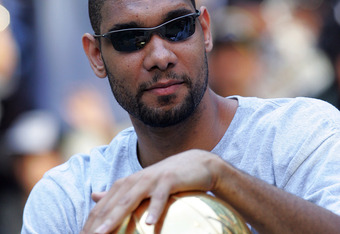 SAN ANTONIO - JUNE 17:  Tim Duncan of the San Antonio Spurs holds the Larry O'Brien trophy during the NBA championship parade down the San Antonio River walk June 17, 2007 in San Antonio, Texas. NOTE TO USER: User expressly acknowledges and agrees that, b