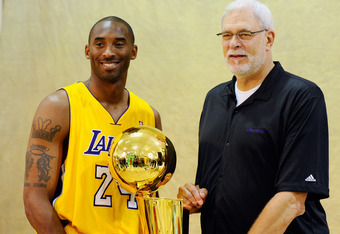 EL SEGUNDO, CA - SEPTEMBER 25:  Kobe Bryant #24 and head coach Phil Jackson of the Los Angeles Lakers pose with NBA Finals Larry O'Brien Championship Trophy during  Media Day at the Toyota Center on September 25, 2010 in El Segundo, California. NOTE TO US