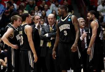 ALBUQUERQUE, NM - MARCH 17:  Head coach Kevin Stallings of the Vanderbilt Commodores talks with the team during the first half against the Wisconsin Badgers during the third round of the 2012 NCAA Men's Basketball Tournament at The Pit on March 17, 2012 i