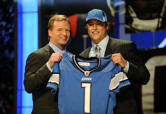 Matthew Stafford, the first overall draft pick of 2009, with Comissioner Roger Goodell.