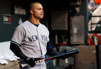 BALTIMORE, MD - APRIL 09: Nick Swisher #33 of the New York Yankees stands in the dugout before the start of the Yankees game against the Baltimore Orioles at Oriole Park at Camden Yards on April 9, 2012 in Baltimore, Maryland.  (Photo by Rob Carr/Getty Im