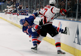 NEW YORK, NY - MAY 16:  Ruslan Fedotenko #26 of the New York Rangers is knocked to the ice by Ilya Kovalchuk #17 of the New Jersey Devils in Game Two of the Eastern Conference Final during the 2012 NHL Stanley Cup Playoffs at Madison Square Garden on May