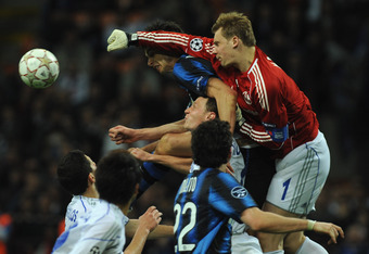 MILAN, ITALY - APRIL 05:  Manuel Neuer of Schalke 04 in action against Andrea Ranocchia of FC Internazionale Milano during the UEFA Champions League Quarter Final match between FC Internazionale Milano and Schalke 04 at San Siro Stadium on April 5, 2011 i