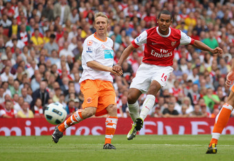 LONDON, ENGLAND - AUGUST 21:  Theo Walcott of Arsenal scores his third goal for a hat-trick during the Barclays Premier League match between Arsenal and Blackpool at The Emirates Stadium on August 21, 2010 in London, England.  (Photo by Clive Rose/Getty I