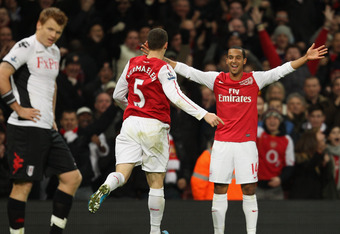 LONDON, ENGLAND - NOVEMBER 26:  Thomas Vermaelen of Arsenal celebrates scoringthe equalising goal with Theo Walcott of Arsenal during the Barclays Premier League match between Arsenal and Fulham at Emirates Stadium on November 26, 2011 in London, England.
