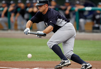 FORT MYERS, FL - MARCH 22:  Outfielder Brett Gardner #11 of the New York Yankees leads off with a bunt against the Boston Red Sox during a Grapefruit League Spring Training Game at JetBlue Park on March 22, 2012 in Fort Myers, Florida.  (Photo by J. Meric