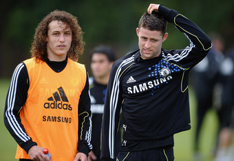 COBHAM, ENGLAND - MAY 15: David Luiz (L) and Gary Cahill of Chelsea walk off the field after training at Chelsea Training Ground on May 15, 2012 in Cobham, England.  (Photo by Laurence Griffiths/Getty Images)